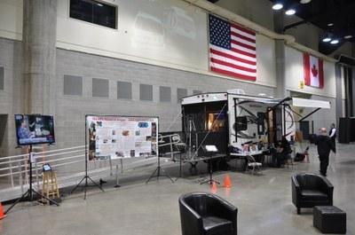 RPG Research van in a warehouse underneath American Flag